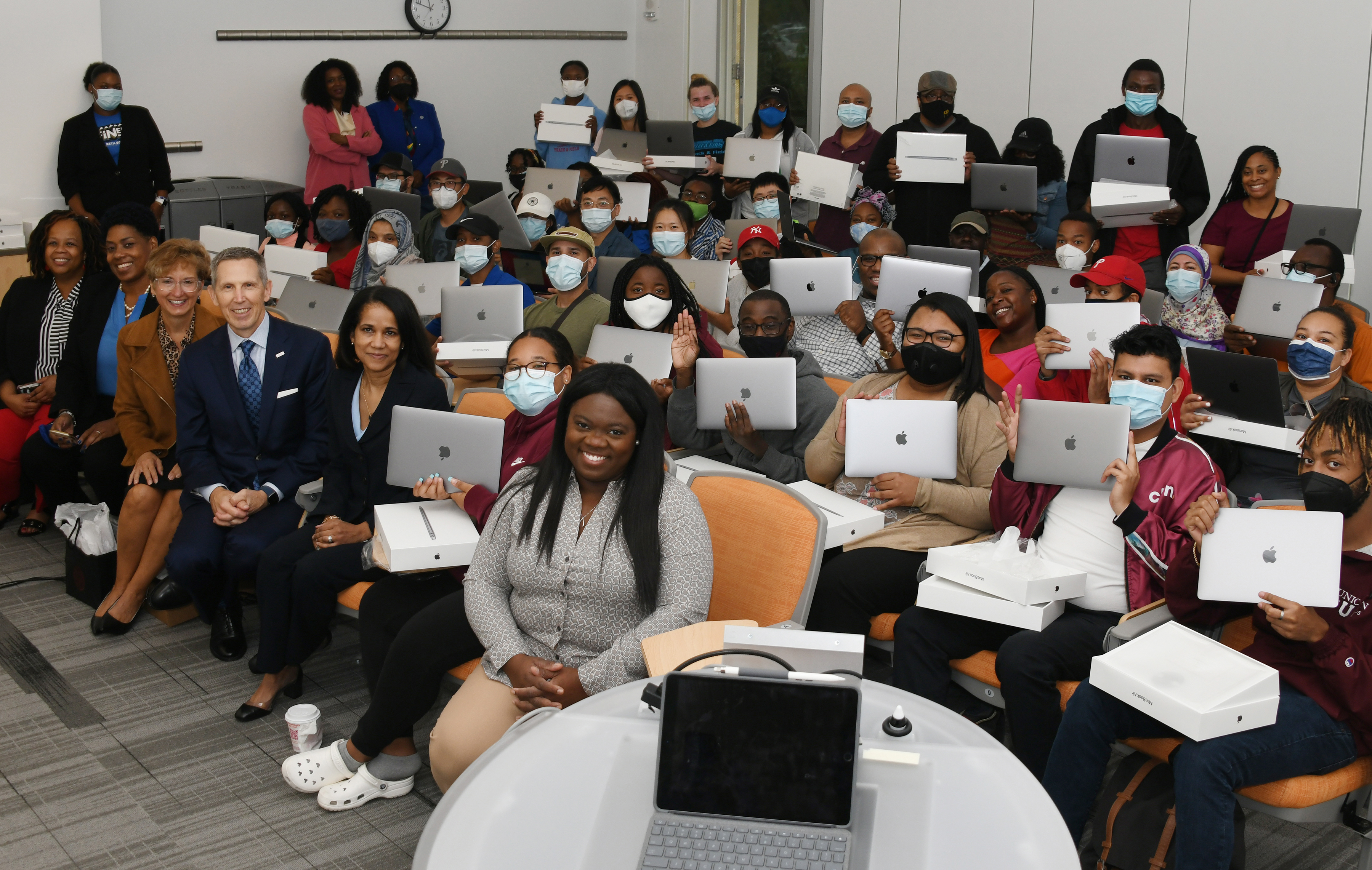 Pictured are some of the STEM graduate students who each received a MacBook from DuPont, which donated 50 of the high-end Apple laptop computers to Delaware State University. Seated in the front row are the DuPont officials that made the donation happen.